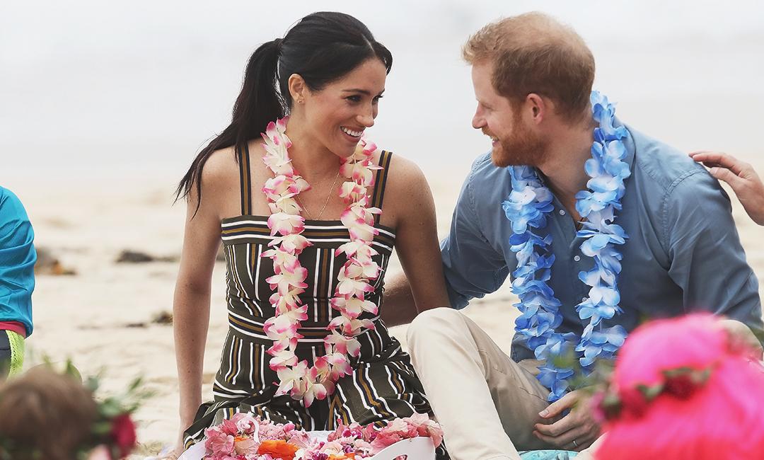 Меган Маркл с принцем Гарри во время совместного тура по Океании.