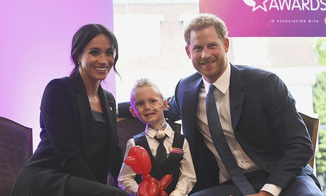 Меган Маркл и принц Гарри во время благотворительного визита